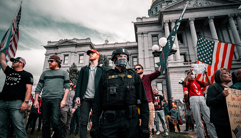 People protesting with police