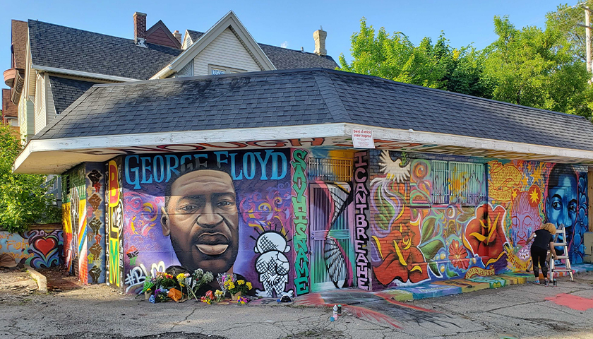 Mural of George Floyd on the side of a building
