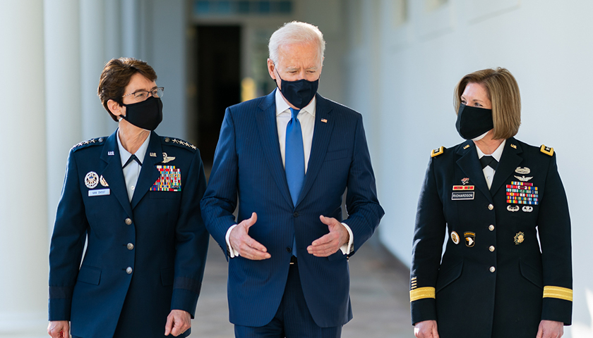 President Joe Biden walks along the Colonnade with the Combatant Commander nominees U.S. Air Force Gen. Jacqueline Van Ovost and U.S. Army Lt. Gen. Laura Richardson on Monday, March 8, 2021, along the Colonnade of the White House.