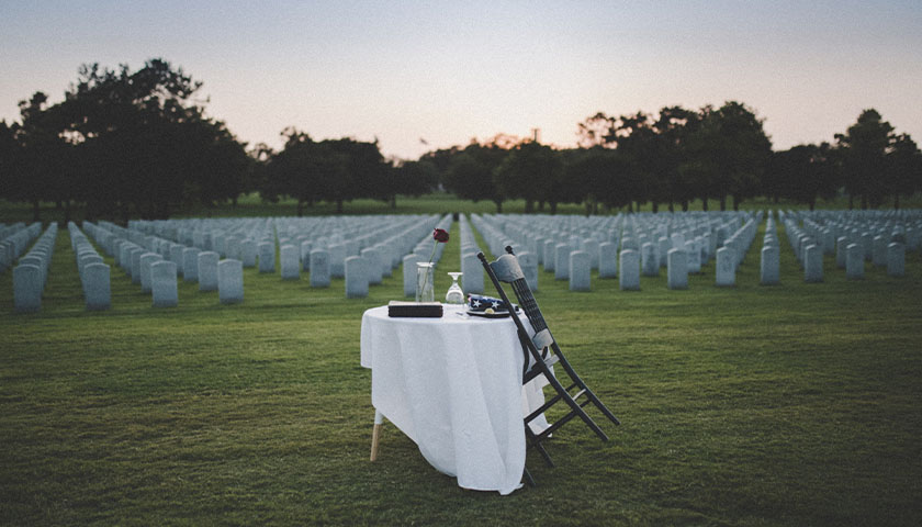 Veteran cemetery with table set for lives lost who served America