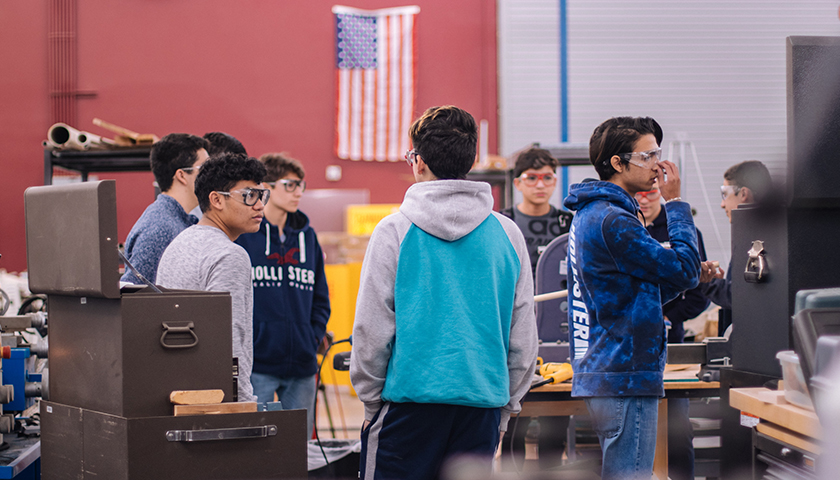 Students in shop class at school with safety goggles on