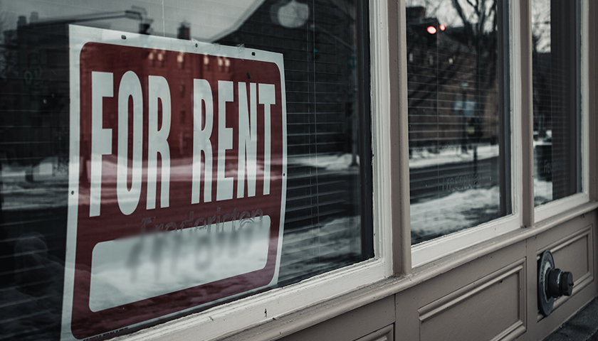 """""""For Rent"""" sign in window of building"""