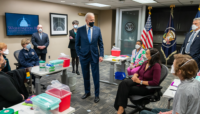President Joe Biden talks to Veterans and VA staff members during a briefing on the vaccine process Monday, March 8, 2021, at the Washington DC Veterans Affairs Medical Center in Washington, D.C.