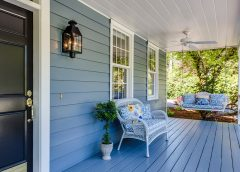 Front porch of a home with chair and plant