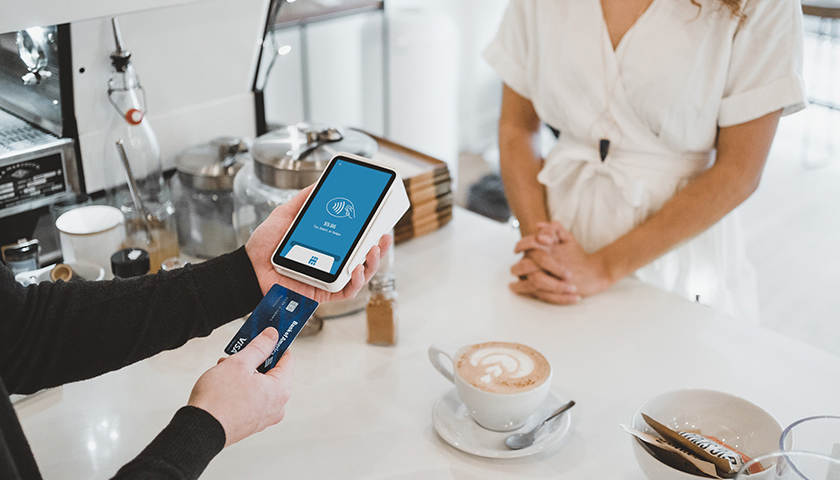 Person using Apple Pay at cafe
