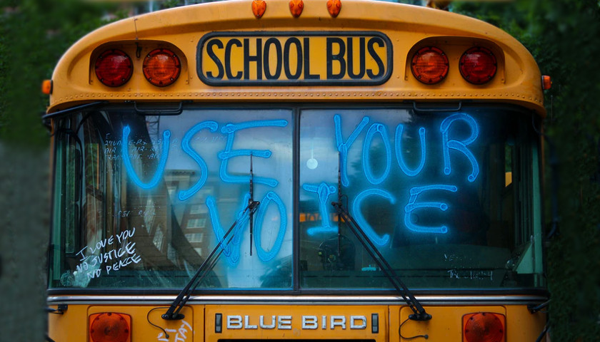 """School bus with """"use your voice"""" on the windshield"""