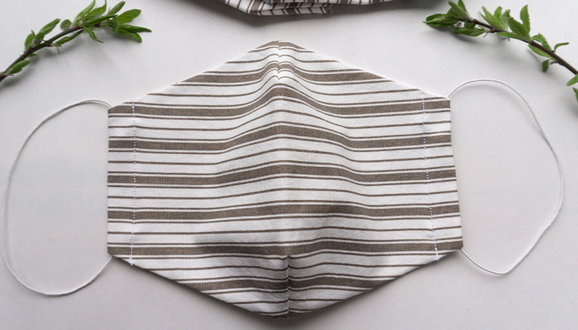 brown and white striped cloth mask
