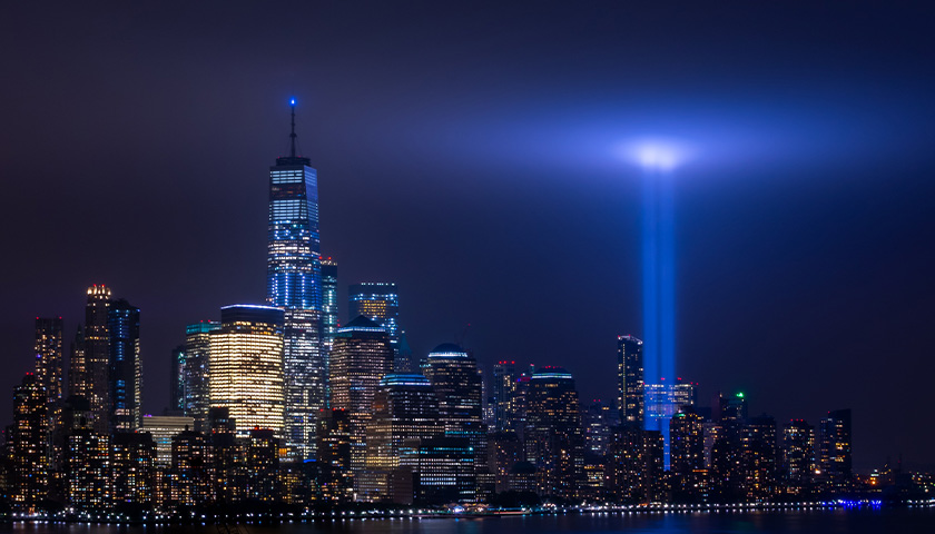 Cityscape of NYC with lights shining where Twin Towers used to be.